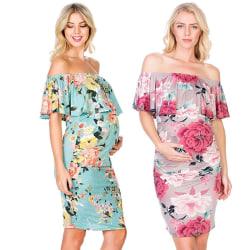 Kvinnas fashionabla klänning med en axel för gravida kvinnor
