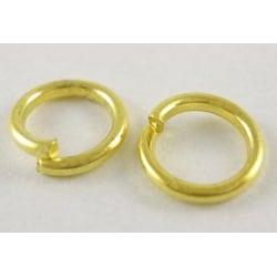 10 gr (Drygt 230st.) Nickelfria guldpläterade motringar  Ø 6 mm.