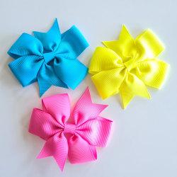 3 hårspännen med stor rosett flerfärgad