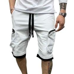 Snygg enfärgad sportfortshorts med flera fickor för män
