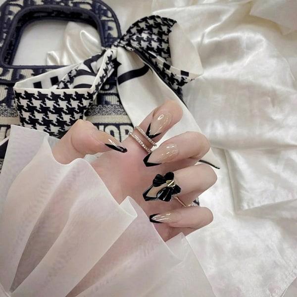 24st svart konstgjord falsk nagelpress på bowknot på full lock nai
