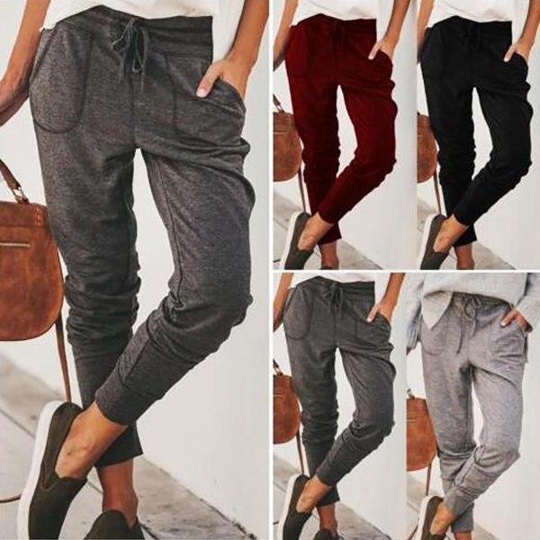 Kvinnors smala raka ben stretchiga avslappnade byxor med fickor svart M