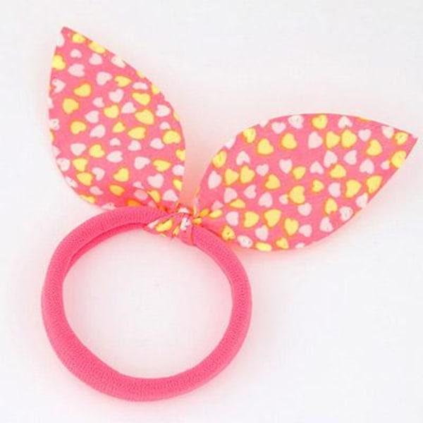 Hårsnodd med Liten Rosett  (rosa/hjärtan) Pink one size