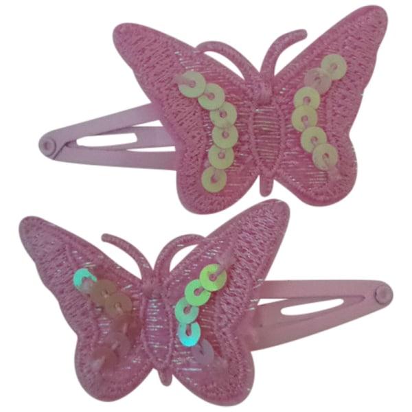 2 rosa hårspännen med fjäril rosa