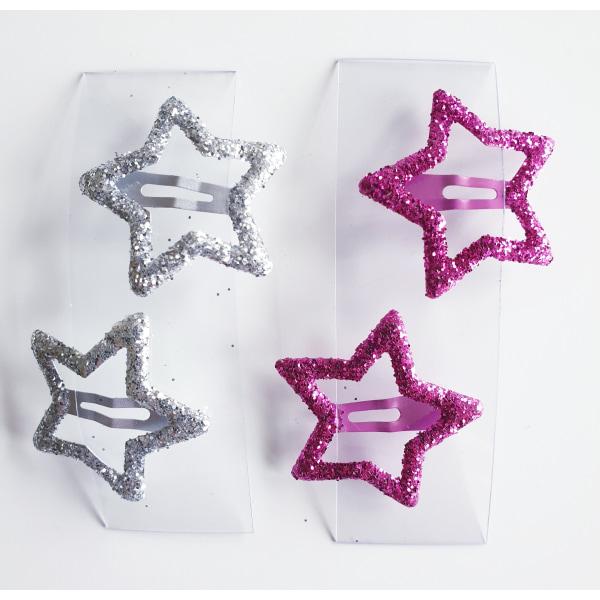 4 hårspännen med glittrig stjärna flerfärgad