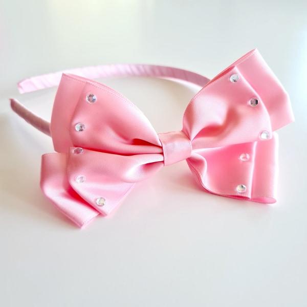 Diadem i satin med rosett rosa