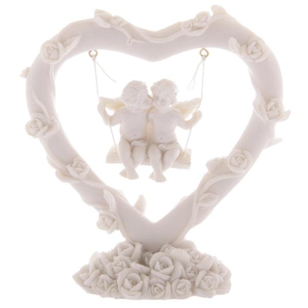Vita änglar gungar i ett hjärta vit
