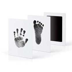 Ingen hudkontakt inget bläck baby- och fotavtryck nyfödda hund Black