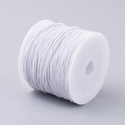 Rulle med  c:a 34-37 mt Vit nylonklädd elastisk tråd 0,6 mm