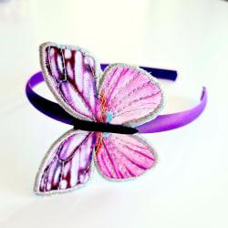 Diadem med stor fjäril med glitter lila