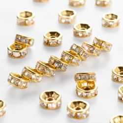 6mm strassrondeller/spacers, guld/klara, 50st
