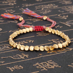 Tibetansk flätad stickning kopparpärlor Lucky Rope Armband Bangl Gold