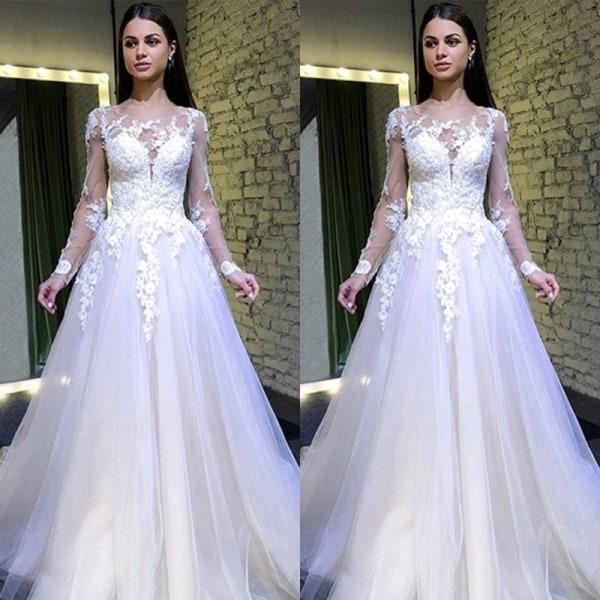 Kvinnas sexiga spets genomskinliga klänning vit bröllopsklänning white M
