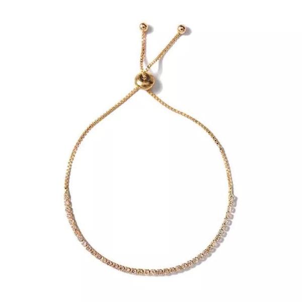 Glittrigt Strass Guld Armband med en rad Vita Rhinestones Guld