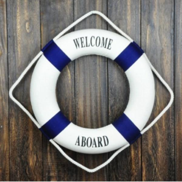 dekorativ livboj, blå med texten welcome abroad