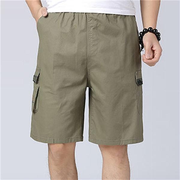avslappnade män solida shorts med flera fickor