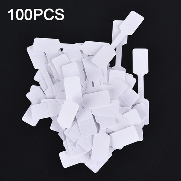 100st vita prisetiketter med hängande strängsmycken Statio