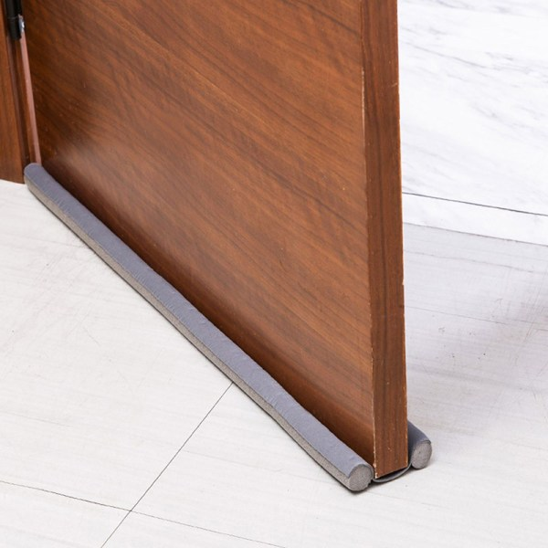dörrbottens tätningslist ljudreducering under dörrvind