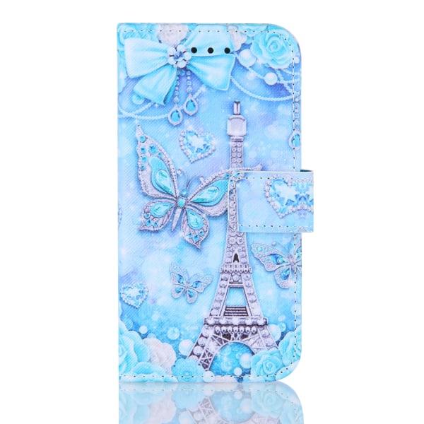 Plånboksfodral iPhone 12/12 Pro GadgetMe - Olika Motiv Silvrigt Eiffeltorn
