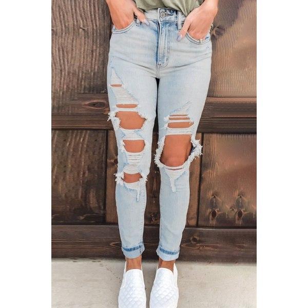 Vintage tvättade nödställda hål jeans med hög midja L