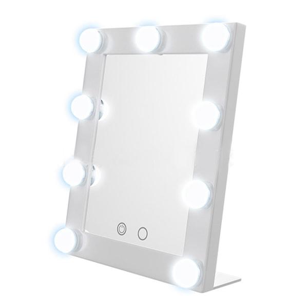 Spegel med sminklampor